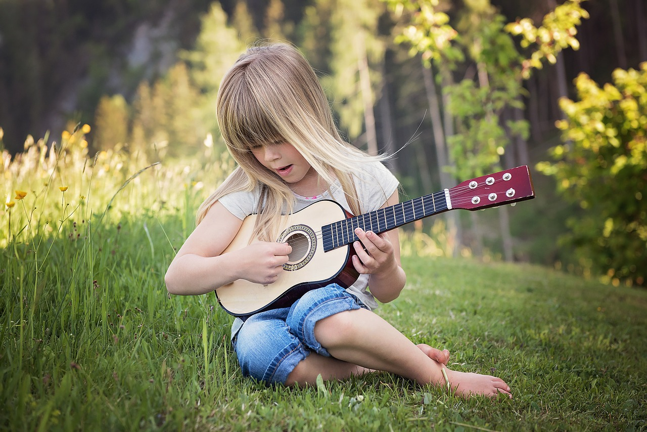 Little Girl Playing Toy Guitar